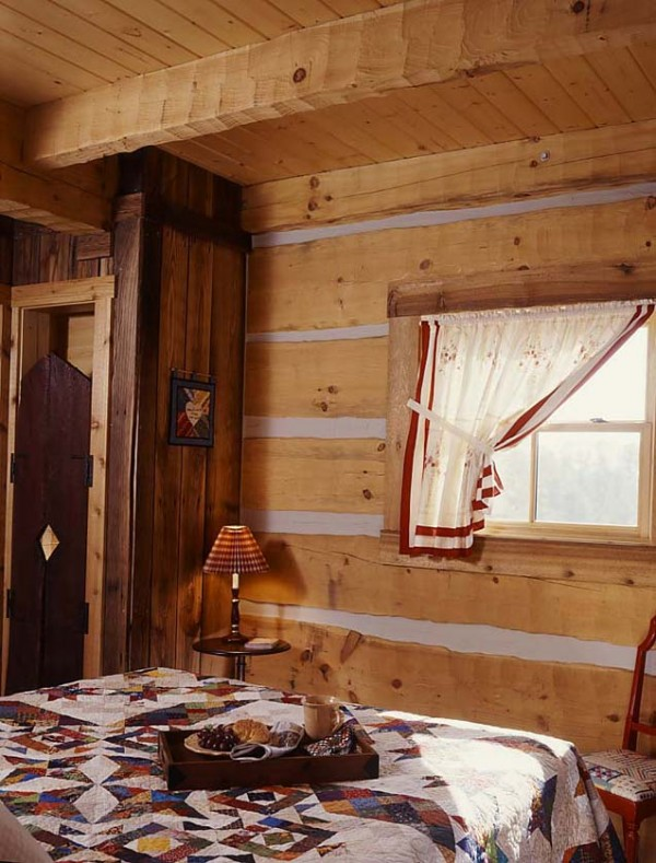 7 tiny cabin bedroom e1290575595784  Cozy Winter Cabin