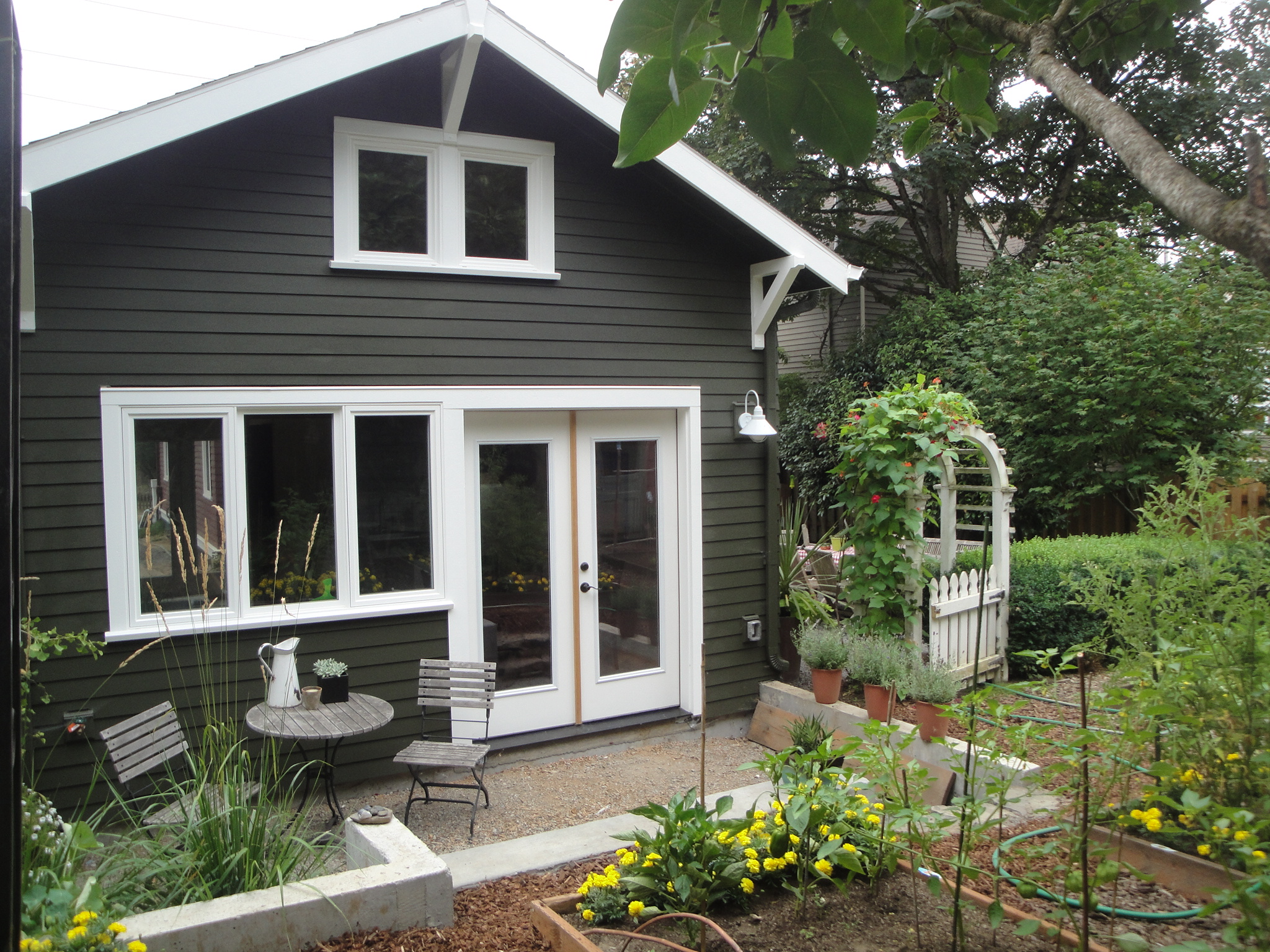 Backyard cottage when it fronts on a rear alley like this it s for Prefab granny unit california