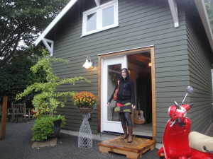 Architect Emily Refi at front of Studio- complete with Vespa scooter!